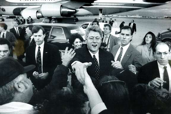 Feb. 21, 1993 - President Bill Clinton moves through a crowd of people who welcome him to Moffitt Field for his visit to Silicon Valley.