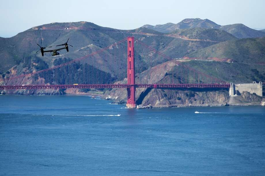A Marine Osprey flies past the Golden Gate Bridge in San Francisco, Friday, Feb. 13, 2015, as part of a convoy carrying President Barack Obama from San Francisco to Palo Alto. Photo: Evan Vucci, Associated Press