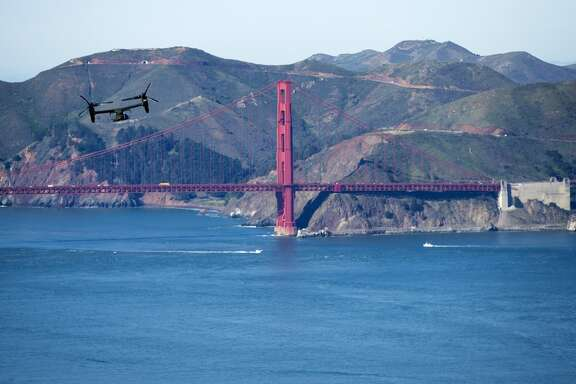 A Marine Osprey flies past the Golden Gate Bridge in San Francisco, Friday, Feb. 13, 2015, as part of a convoy carrying President Barack Obama from San Francisco to Palo Alto, Calif. for a summit on cybersecurity and consumer protection at Stanford University. (AP Photo/Evan Vucci)