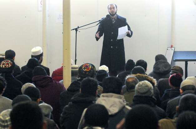 Imam Hassan Shawa conducts the midday prayer and memorial service Friday Feb. 13, 2015, at the Masjid As-Salam Mosque in Albany, N.Y., for Ashiqur Rahman, the 4-year-old boy hit by a garbage truck Thursday on Central Avenue. (Michael P. Farrell/Times Union) Photo: Michael P. Farrell / 00030605A