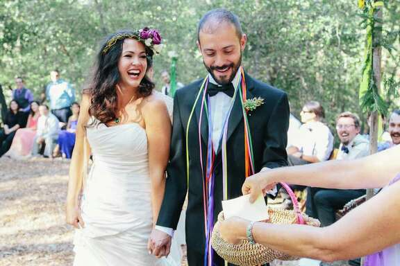 Liz Oettinger collects guests' written wishes and prayers for the happy couple, Alex Karson and Hank Thompson.