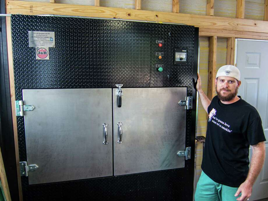 Will Buckman of CorkScrew BBQ with his new Oyler barbecue pit. Photo: J.C. Reid / ONLINE_YES