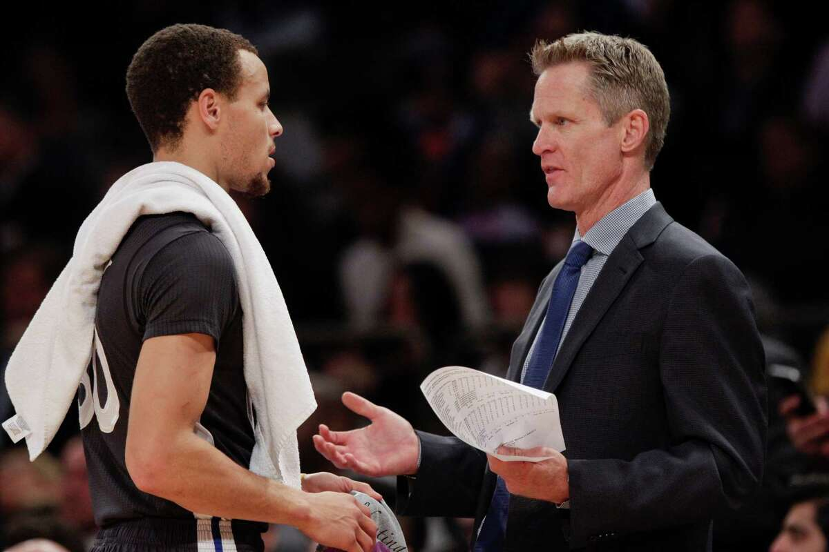 Golden State Warriors coach Steve Kerr, a former Spurs player, talks to Stephen Curry during the first half against the New York Knicks on Feb. 7, 2015, in New York.