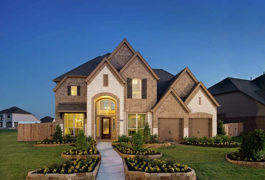 Perry offers new designs in woodforest houston chronicle for Perry home designs