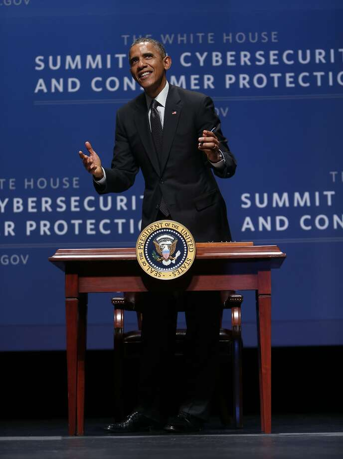 U.S. President Barack Obama jokes with the audience while signing an executive order at Cybersecurity and Consumer Protection at Memorial Auditorium at Stanford University in Stanford, Calif. on Friday, February 13, 2015. Photo: Scott Strazzante, The Chronicle