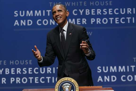 U.S. President Barack Obama jokes with the audience while signing an executive order at Cybersecurity and Consumer Protection at Memorial Auditorium at Stanford University in Stanford, Calif. on Friday, February 13, 2015.