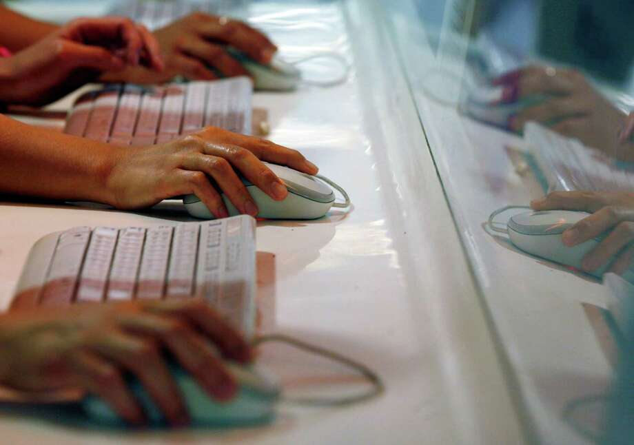 In a tactic to confuse computer users, and enhance their chances of a  payout, the new strain scrambles the names of files, giving each a  completely unique name. Photo: Associated Press File Photo / AP