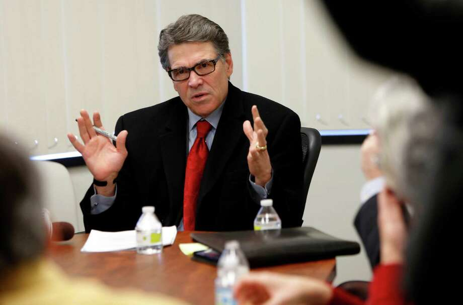 Former Gov. Rick Perry's line-item veto of funding for the Public Integrity Unit in Austin reeks of political peevishness and payback. And bad governance. Photo: Jim Cole /Associated Press / AP