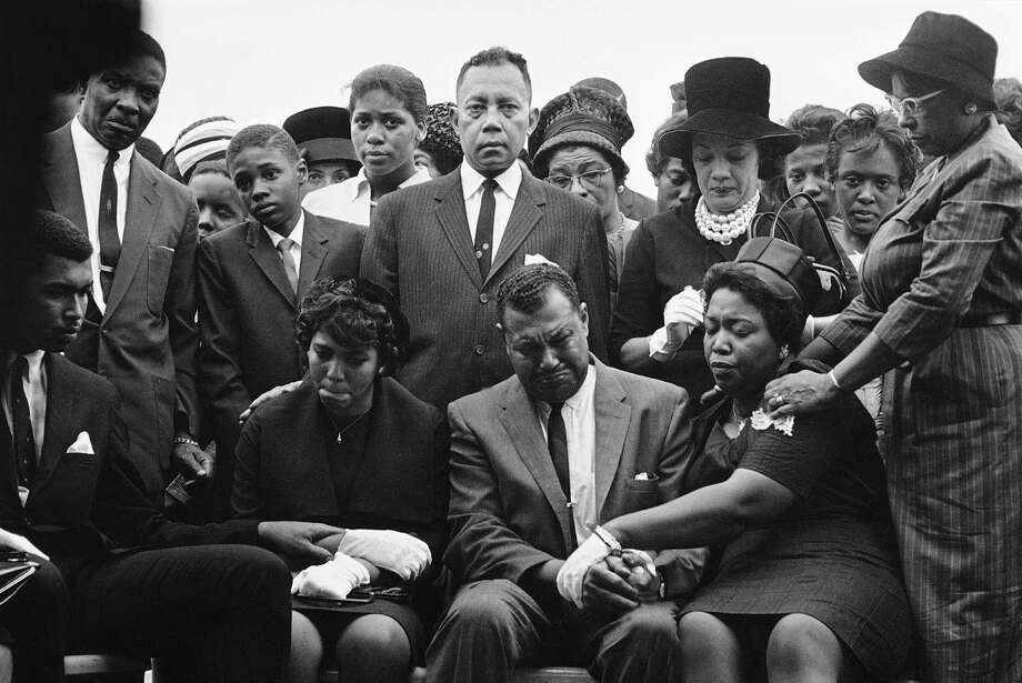 The family of Carol Robertson, a 14-year-old African American girl killed in a church bombing, attend graveside services for her in 1963 in Birmingham, Alabama. A reader recalls that tragic event. Photo: Horace Cort /AP / 1963 AP