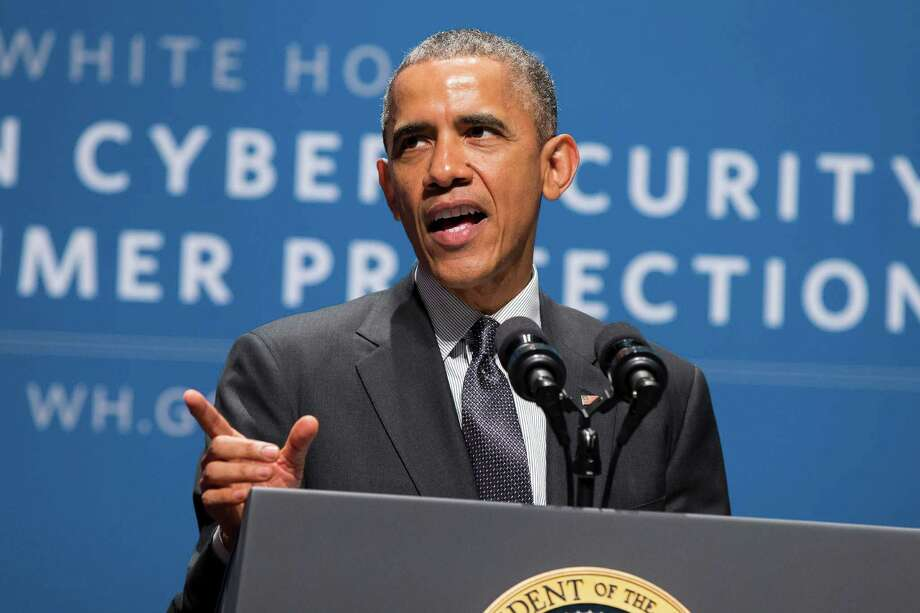 """President Barack Obama speaks during a summit on cybersecurity and consumer protection, Friday, Feb. 13, 2015, at Stanford University in Palo Alto, Calif. The president said cyberspace is the new """"wild West"""" _ with daily attempted hacks and people looking to the government to be the sheriff. He's asking the private sector to do more to help.  (AP Photo/Evan Vucci) Photo: Evan Vucci, STF / AP"""
