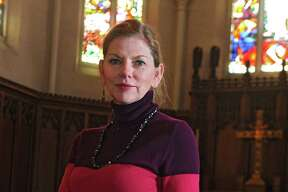 Rev. Jo Page stands in the sanctuary at St. John's Lutheran Church on Tuesday, Feb. 10, 2015 in Albany, N.Y. (Lori Van Buren / Times Union)