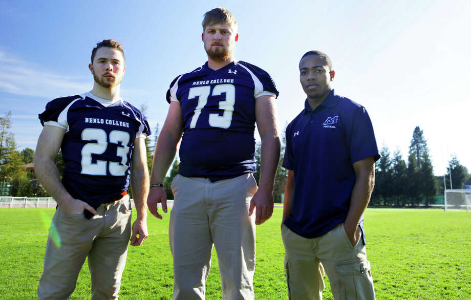 Jake Fohn (23), Bryce Howard (73) and Daniel Jones were among those affected when Menlo College dropped football. Photo: Terray Sylvester / The Chronicle / ONLINE_YES