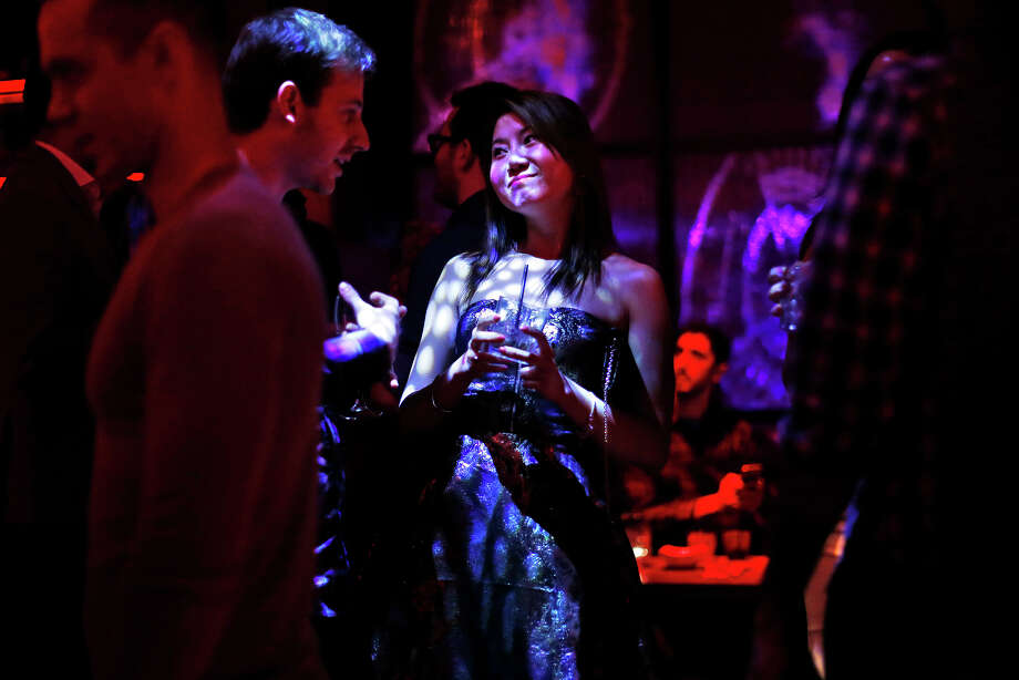 Alice Tse and Dan Smith talk with each other during the Valentine's Day party for the League, a San Francisco company's dating app. Photo: Scott Strazzante / The Chronicle / ONLINE_YES