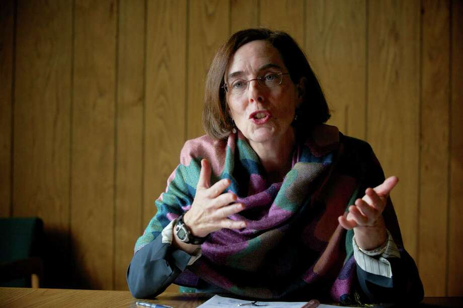 Oregon Secretary of State Kate Brown will become the state's next governor since it does not have a lieutenant governor. She replaces Gov. John Kitzhaber, embroiled in alleged ethics violations. Photo: MICHAEL LLOYD, MBI / The Oregonian