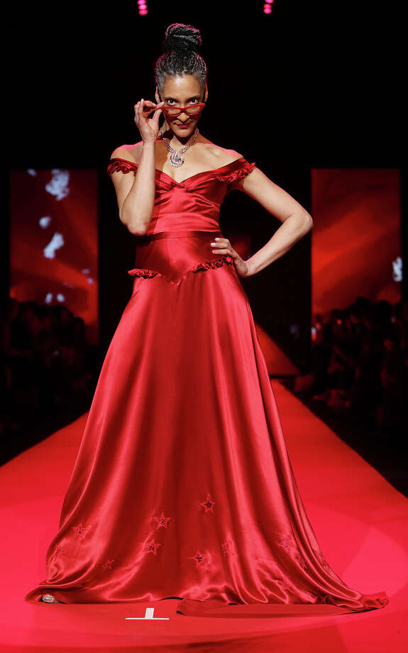 """The Chew"" star chef Carla Hall walks the runway in a dress designed by Stephanie Bodnar for the Go Red for Women celebrity fashion show. Photo: Kristina Bumphrey / Associated Press / STARPIX"