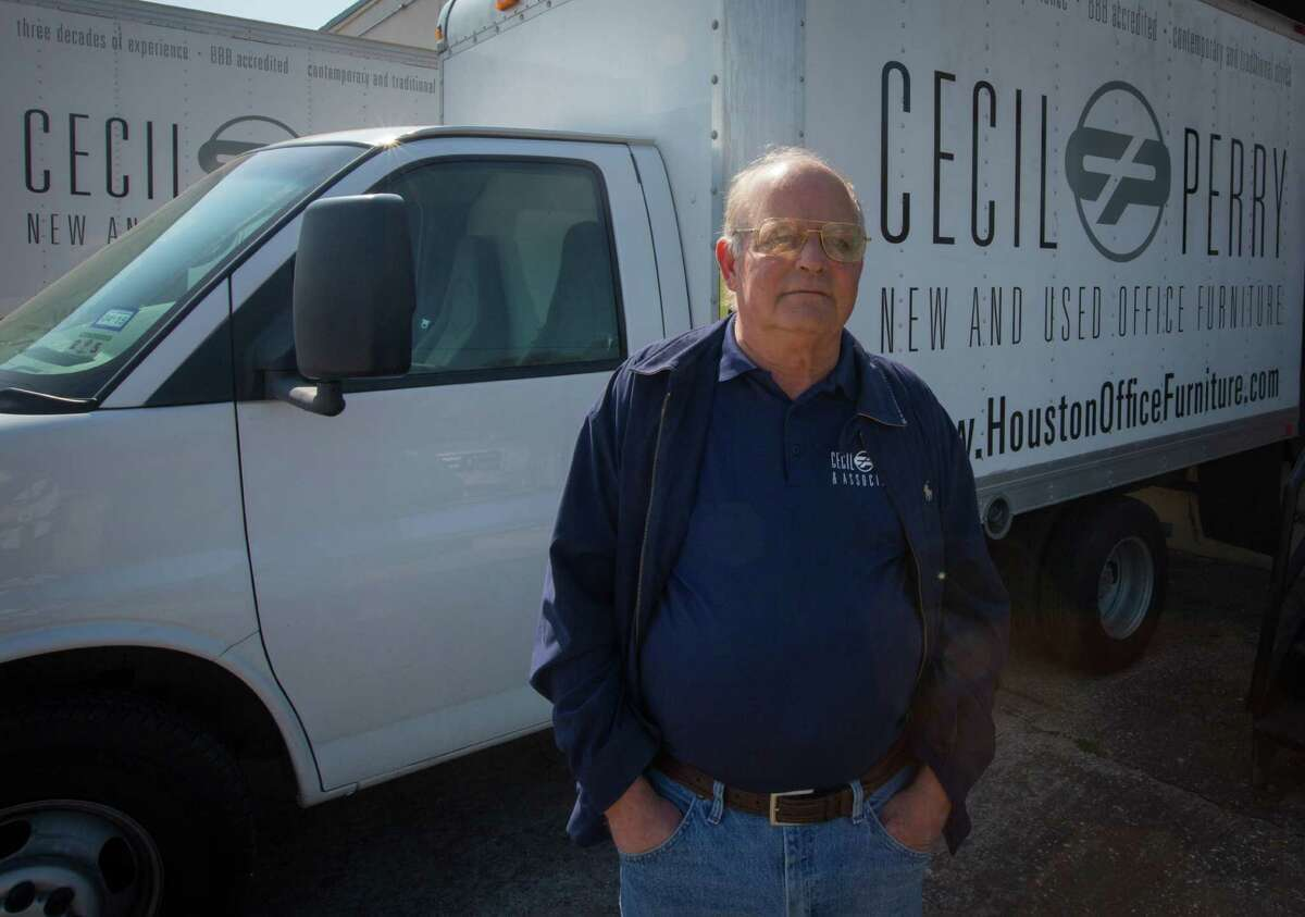Cecil Perry, owner of Cecil Perry & Associates, a supplier of office furniture at his warehouse in North Houston, Thursday February 12, 2015. Perry said he doesn't expect to struggle, but some of the oil companies that were once big customers are no longer ordering and others are trying to sell him used furniture as a result of downsizing. (Billy Smith II / Houston Chronicle)
