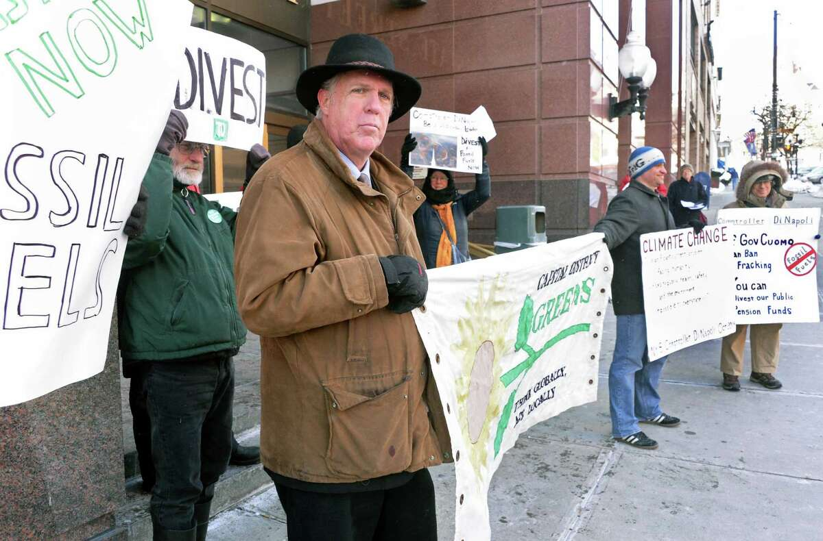 Mark Dunlea, left, of NYS Green party education and legal fund during a rally to urge NYS to divest all pension funds from fossil fuels outside the the NYS Comptrollers office Friday Feb. 13, 2015, in Albany, NY. (John Carl D'Annibale / Times Union)