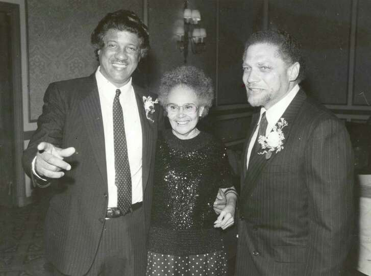 Houston trailblazers City Councilman Judson Robinson Jr., left, and Hattie Mae White in 1987.  They were   Houston's first black council member and school trustee,  respectively. With them is Houston Congressman Mickey Leland.