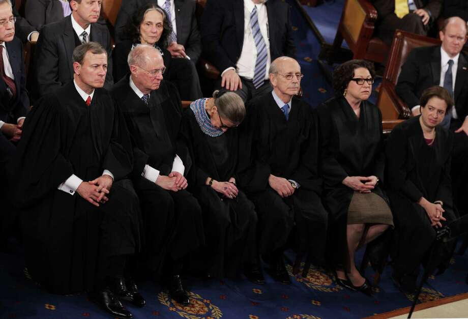 """Supreme Court Justice Ruth Bader Ginsburg, center, admits she nodded off during President Barack Obama's State of the Union speech. """"As I often do,"""" she joked this week during an appearance with Justice Antonin Scalia. Photo: Alex Wong, Staff / 2015 Getty Images"""