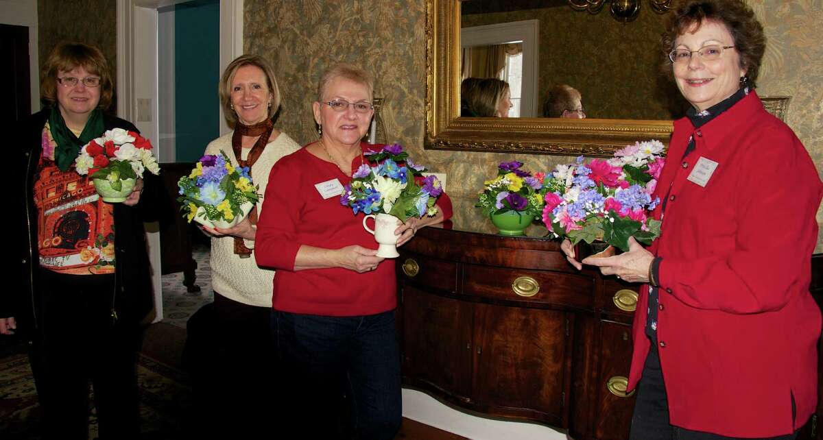 The Blue Creek Garden Club of Latham made baskets for the Emeritus at Colonie Manor for February. The baskets will be delivered and used to decorate the dining room tables for the seniors who live there. Participating were, from left, Donna Ferlazzo, Enza Capara, Cindy Campbell and Priscilla Johnson.(Beverly Ebeling)