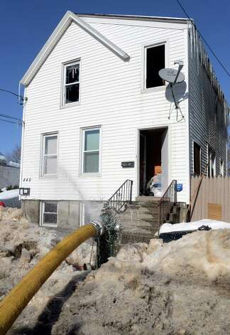 Fire scene at 449 Second Street, right, Friday Feb. 13, 2015, in Albany, NY.  (John Carl D'Annibale / Times Union) Photo: John Carl D'Annibale