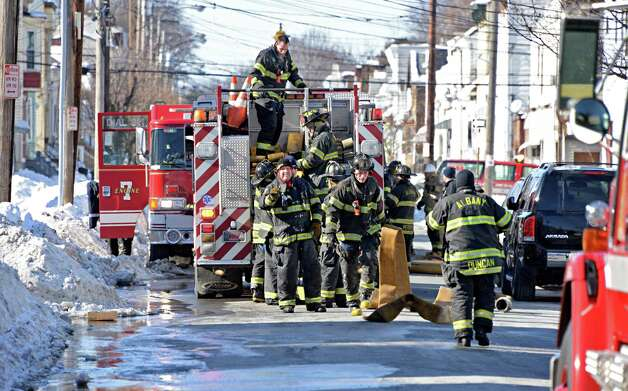Albany firefighters on the scene of a fire at 449 Second Street Friday Feb. 13, 2015, in Albany, NY.  (John Carl D'Annibale / Times Union) Photo: John Carl D'Annibale