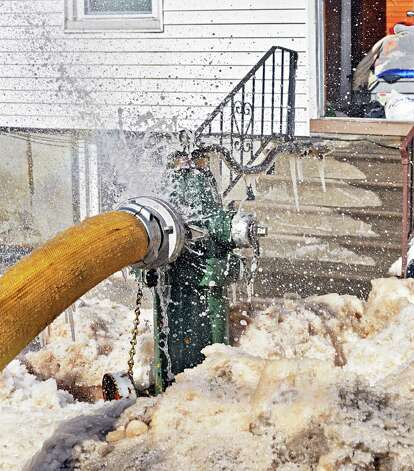 Ice covered hydrant at 449 Second Street, right, Friday Feb. 13, 2015, in Albany, NY.  (John Carl D'Annibale / Times Union) Photo: John Carl D'Annibale
