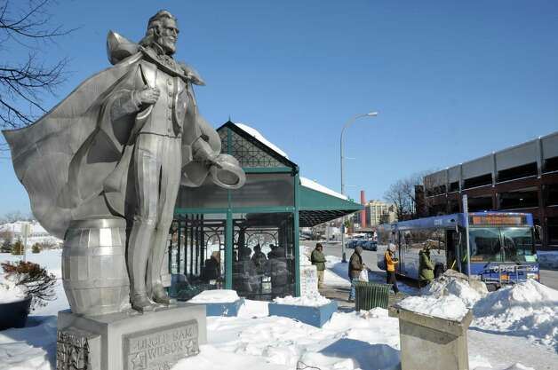 Riders board a bus at the CDTA Uncle Sam bus stop on River Street Friday morning, Feb. 13, 2015, in Troy, N.Y. (Michael P. Farrell/Times Union) Photo: Michael P. Farrell / 00030616A