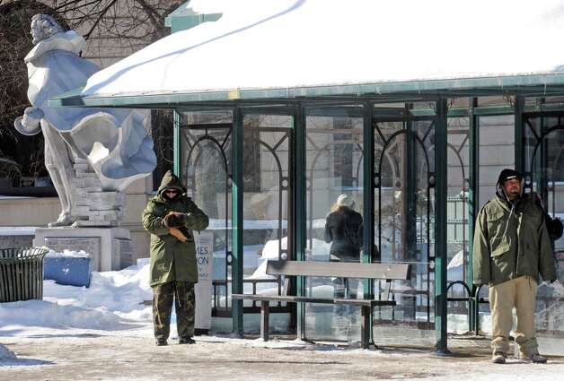Riders wait at the CDTA Uncle Sam bus stop on River Street Friday morning, Feb. 13, 2015, in Troy, N.Y. (Michael P. Farrell/Times Union) Photo: Michael P. Farrell / 00030616A