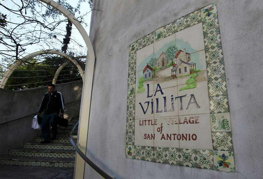 A person walks down a set of stairs near La Villita on Thursday, Feb. 12, 2015. The city is also investing in improvements to the downtown historic site such as new lighting in Maverick Plaza, updates and repairs at the Arneson Theater. Photo: Kin Man Hui /San Antonio Express-News / ©2015 San Antonio Express-News
