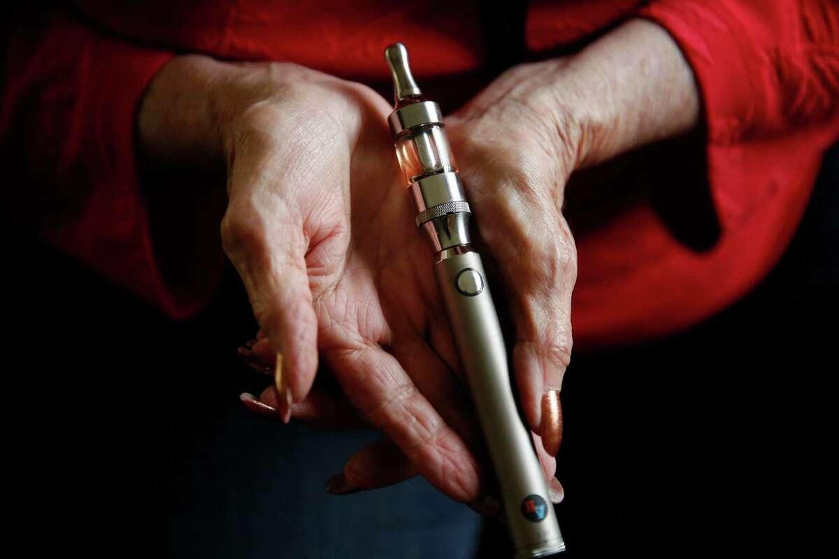 Longtime smoker Roberta Keller, 72, holds her vaporizer in her home in Sunnyvale.