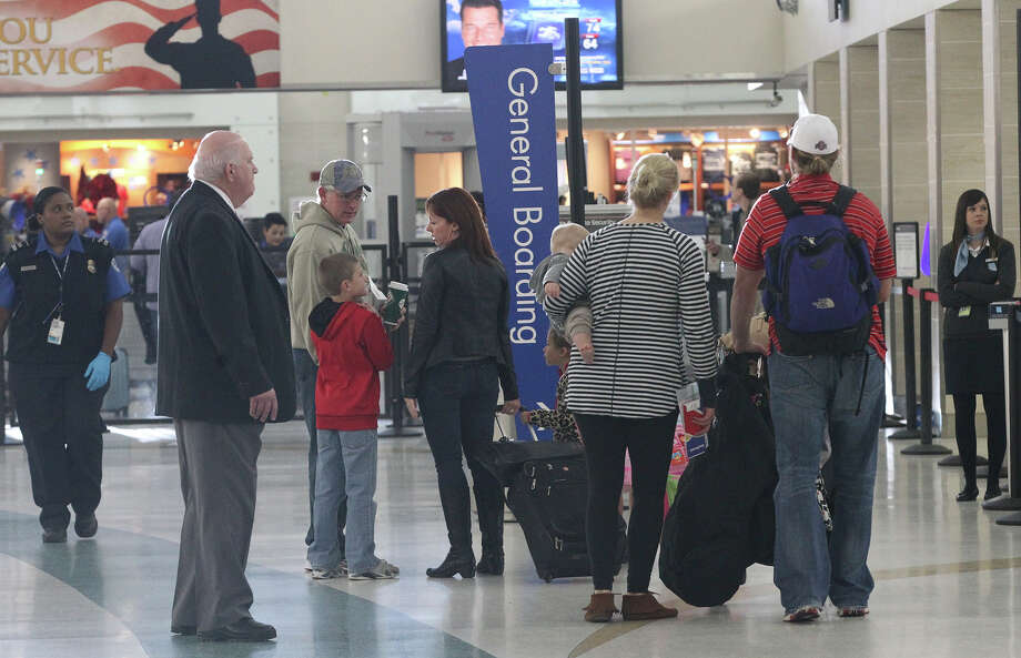The San Antonio International Airport set a passenger record last year, when total passenger arrivals and departures reaching nearly 8.4 million, airport officials said Friday. Photo: JOHN DAVENPORT /San Antonio Express-News / ©San Antonio Express-News/John Davenport