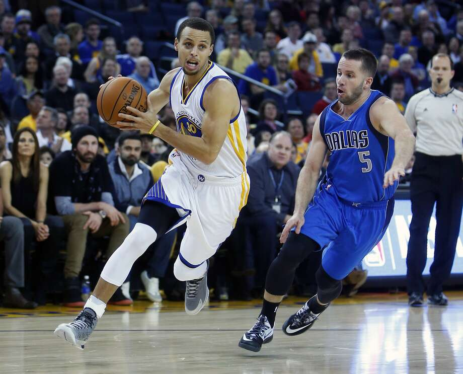 Golden State Warriors' Stephen Curry drives past the Dallas Mavericks' JJ Barea during Curry's 51 point performance at Oracle Arena in Oakland, Calif. on Wednesday, February 4, 2015. Photo: Scott Strazzante, The Chronicle