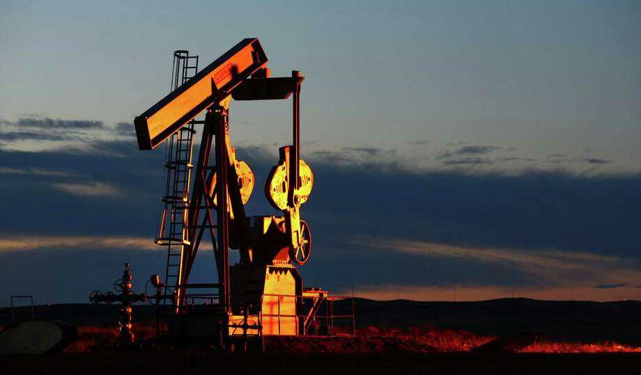 A pumpjack brings up oil in North Dakota, where daily production grew to nearly 1.2 million barrels a day in December, even though drilling declined and oil prices fell.  Photographer: Matthew Staver/Bloomberg Photo: Matthew Staver / © 2011 Bloomberg Finance LP
