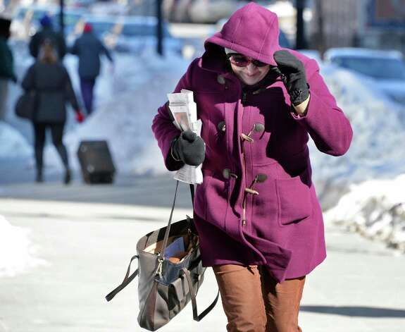 Betsy Parmerter of Latham fights wind and cold as she makes her way along Pearl Street Friday Feb. 13, 2015, in Albany, NY.  (John Carl D'Annibale / Times Union) Photo: John Carl D'Annibale / 00030608A