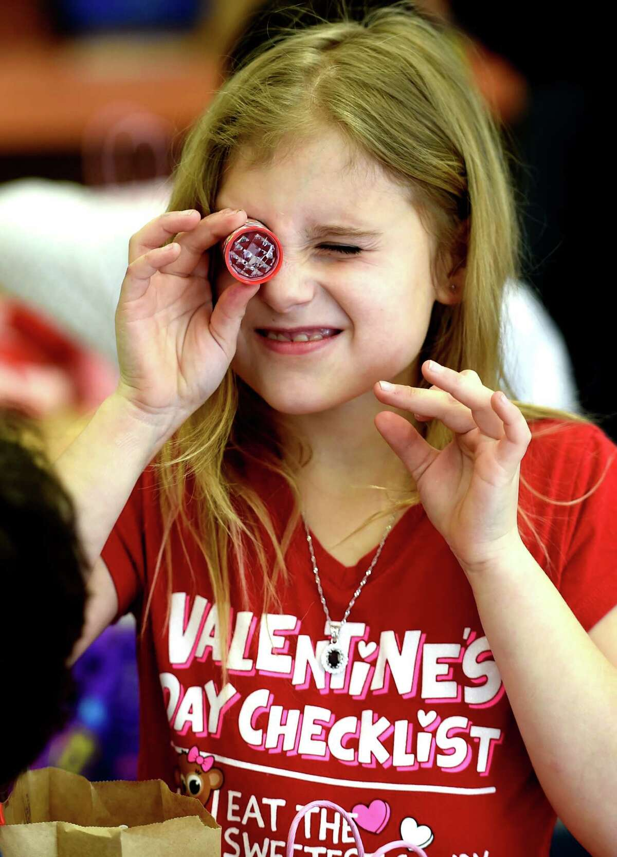 Carmella Banta looks through a calydiscope which was given to her as a Valentine's Day gift Friday afternoon Feb. 13, 2015 at the Elmer Elementary School in Schenectady, N.Y. The occasion was Mrs. Jennifer Rodecker's class Valentine's Day celebration. (Skip Dickstein/Times Union)