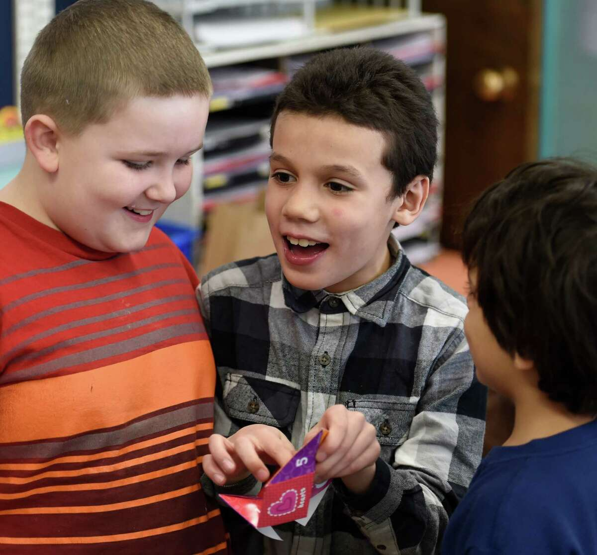 Stephen Torres, center, plays a Valentine's Day game Friday afternoon Feb. 13, 2015 at the Elmer Elementary School in Schenectady, N.Y. Torres is joined by Alex Keary, left and Mohammed Ali, right during the activity. The occasion was Mrs. Jennifer Rodecker's class Valentine's Day celebration. (Skip Dickstein/Times Union)