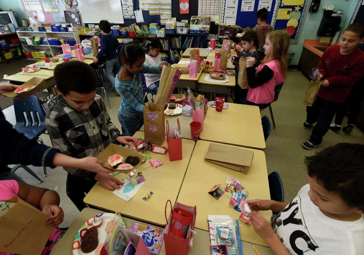 Mrs. Rodecker's class enjoys the Valentine's Day party Friday afternoon Feb. 13, 2015 at the Elmer Elementary School in Schenectady, N.Y. The occasion was Mrs. Jennifer Rodecker's class Valentine's Day celebration. (Skip Dickstein/Times Union)