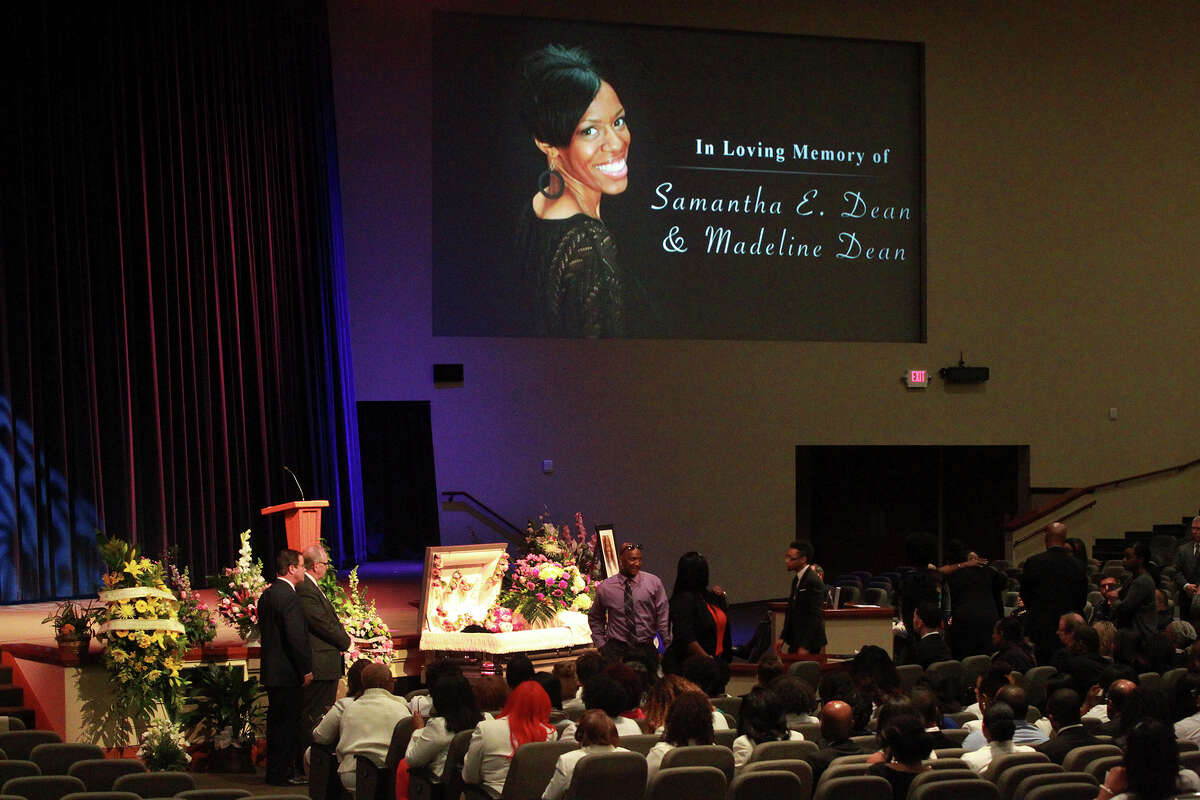 Mourners pay respects Friday February 13, 2015 at the casket of Samantha Elizabeth Dean during her funeral at Community Bible Church in San Antonio. Dean, who worked for the Kyle, Texas Police Department as the coordinator for its Victims Service Unit, was found dead on February 4 lying next to a car behind a building near Bastrop, Texas. Dean, who was pregnant, was shot in the head.