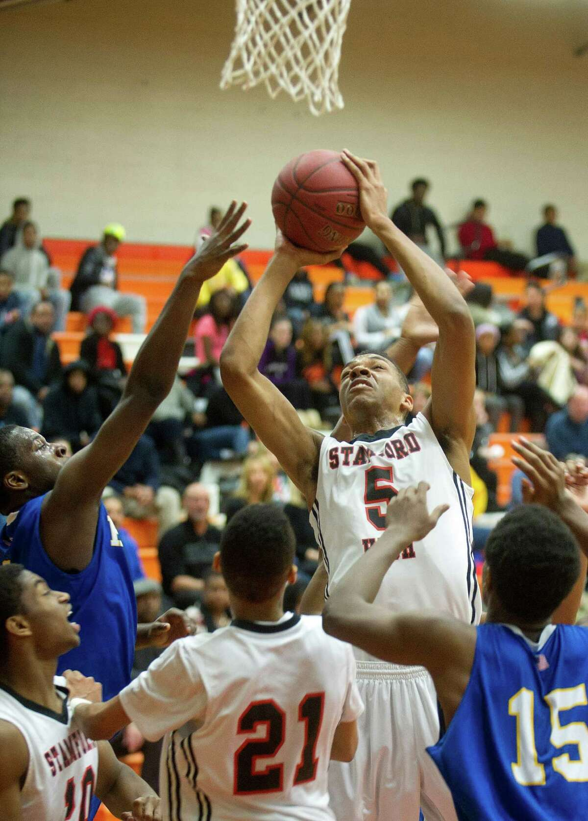 Stamford's Kweshon Askew jumps to take a shot against Harding during Friday's basketball game at Stamford High School on February 13, 2015.