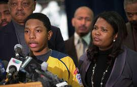 Brandon Green, a player for the Jackie Robinson West Little League baseball team, speaks alongside his mother, Venisa.