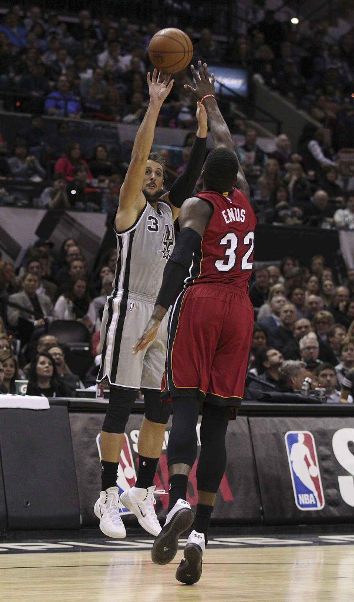 Spurs' Marco Belinelli (03) attempts a three against Miami Heat's James Ennis (32) at the AT&T Center on Friday, Feb. 6, 2015. (Kin Man Hui/San Antonio Express-News)