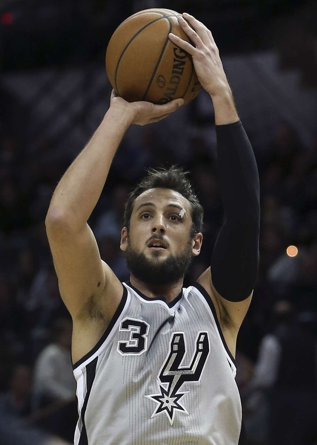 Marco Belinelli shoots a three as the Spurs play the Phoenix Suns at the At&T Center on January 9, 2015.