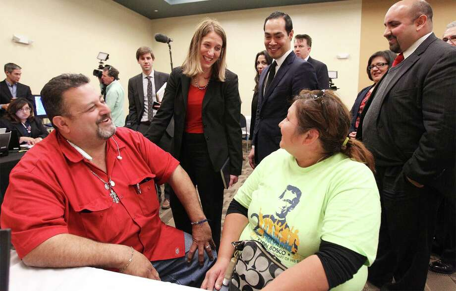 U.S. Secretary of Health and Human Services Sylvia Burwell, center, and U.S. Secretary of Housing and Urban Development Julian Castro, standing right of Burwell, visited with Robert and Linda Contreras in San Antonio earlier this year as the couple enrolled in health insurance at CentroMed. Mid-priced silver plans proved more popular among consumers going through federal and state exchanges to buy health insurance, a Commonwealth Fund report found. Shoppers who bypassed the exchanges and paid full price for their health insurance were more open to buying pricier gold and platinum plans than consumers shopping in the federal and state venues, the report said. Photo: San Antonio Express-News /File Photo / ©2015 San Antonio Express-News