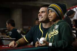 Catcher Josh Phegley introduces himself to A's fans, including 7-year-old David Avina of Salinas, during last Sunday's FanFest. Phegley was acquired in the Jeff Samardzija trade.