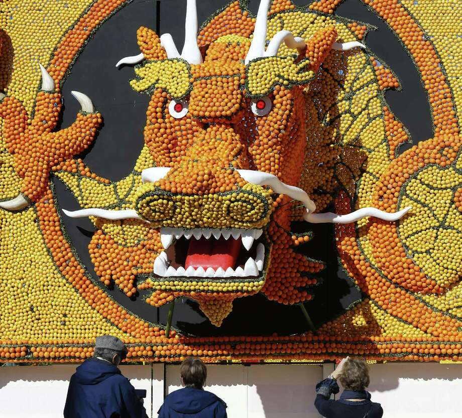 "People take pictures of a sculpture, made of oranges and lemons on February 12, 2015 in Menton on the French Riviera, ahead of the start of the ""Fete du Citron"" (Lemon Festival). The theme of this 82nd edition, running from February 14 until March 4, 2015, is called 'the tribulations of a lemon in China.' Photo: VALERY HACHE, AFP / Getty Images / AFP"