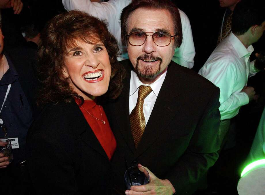 """FILE-This Jan. 9, 2002 file photo """"Rowan & Martin's Laugh-In"""" co-stars Ruth Buzzi and Gary Owens share a laugh during NBC's 75th Anniversary Party, in Los Angeles. Owens, best known for announcing """"Rowan and Martin's Laugh-In,"""" died, Thursday, Feb. 12, 2015 at his Los Angeles-area home. He was 80 years old. (AP Photo/Rene Macura,File) Photo: RENE MACURA, STR / AP"""