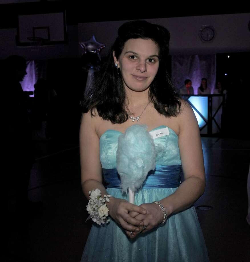 "Jessica Adams, of Oxford, found cotton candy in a color to match her dress at ""Night to Shine"", a prom for people with special needs, which was sponsored by the Tim Tebow Foundation and hosted by Faith Church, of New Milford,  on Friday night, February 13, 2015, in New Milford, Conn. The evening of prom style dining and dancing was one of 44 held in participating churches across the country on Friday night. Photo: H John Voorhees III / The News-Times"
