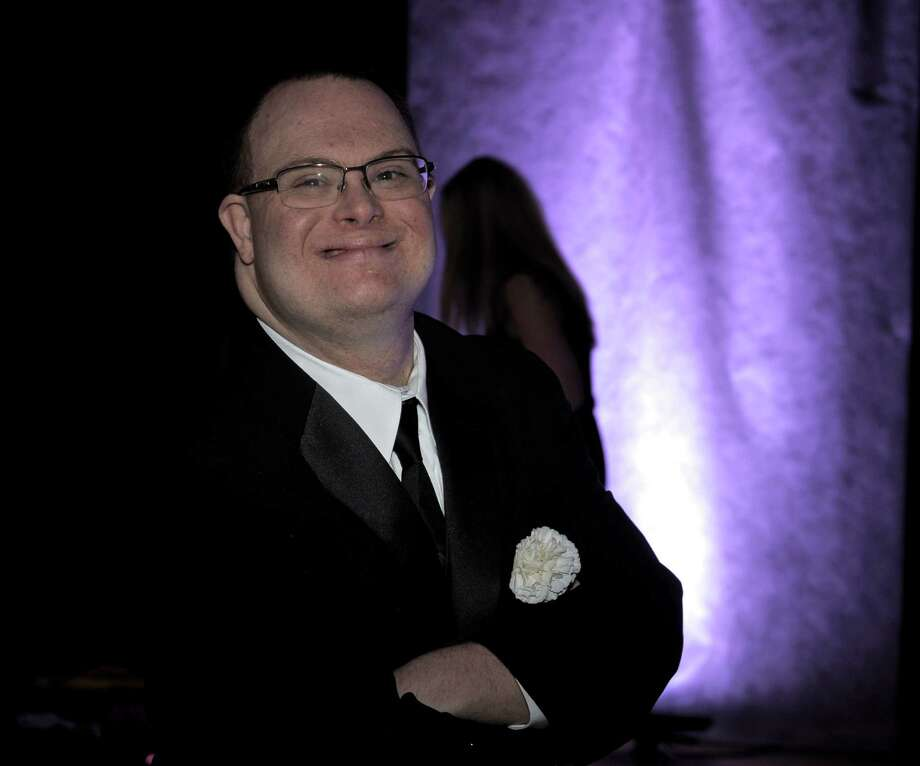 "Ian Snyder, of Danbury, attended ""Night to Shine"", a prom for people with special needs, which was sponsored by the Tim Tebow Foundation and hosted by Faith Church, of New Milford,  on Friday night, February 13, 2015, in New Milford, Conn. The evening of prom style dining and dancing was one of 44 held in participating churches across the country on Friday night. Photo: H John Voorhees III / The News-Times"