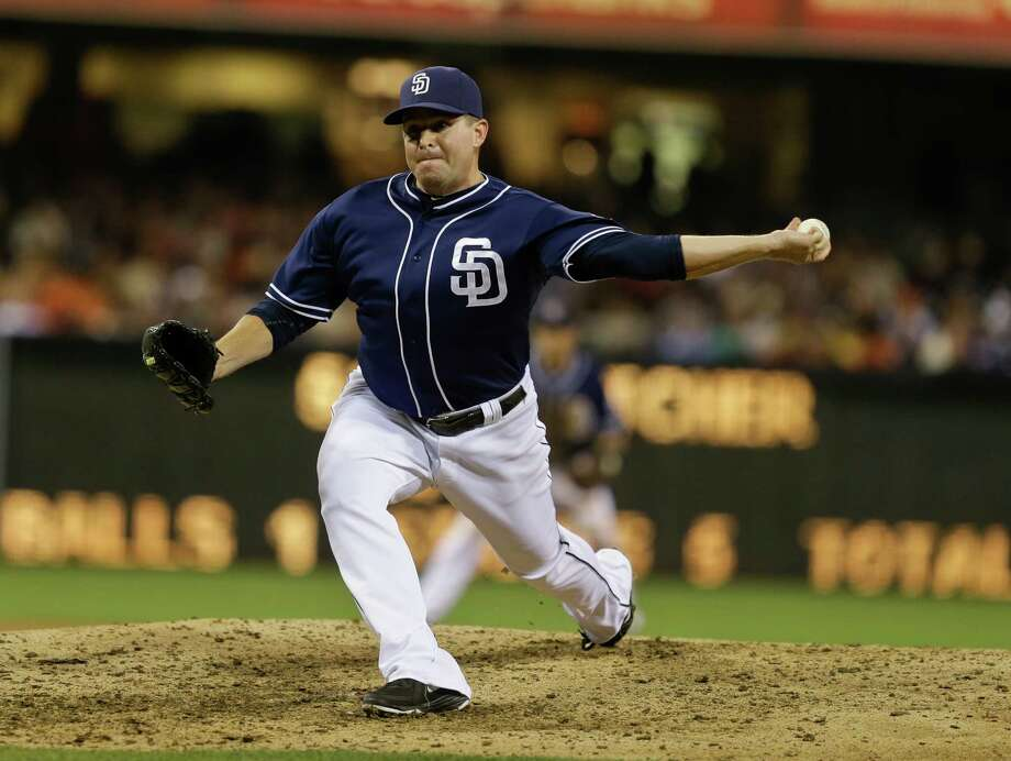 In this July 13, 2013 photo, San Diego Padres pitcher Joe Thatcher throws against the San Francisco Giants in San Diego. The Arizona Diamondbacks have sent struggling right-hander Ian Kennedy to the Padres for Thatcher, a minor leaguer and a draft pick. (AP Photo/Lenny Ignelzi, Fileq) Photo: Lenny Ignelzi, STF / AP